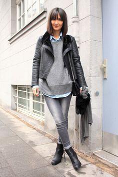 Blue shirt, gray sweater, silver jeans, black shearling jacket