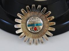 Check out this item in my Etsy shop https://www.etsy.com/listing/480500890/vintage-sterling-silver-hopi-turquoise