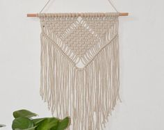 Gorgeous macrame wall hanging to lend a bohemian feel to your bedroom, living Room, wedding or workspace, this macrame will add instantly warmth and texture to any room of your house! All of my macrames are handmade with love by mylself 45 x 39, 139cm x100cm incloud the wood made with 100 % natural cotton rope ^^^^^^^^^^^^^^^^ CUSTOM ORDERS: Want a smaller or larger size? Or a different style that represents you or a loved one? Just send me a convo. ^^^^^^^^^^^^^^^^^ Please contact me...