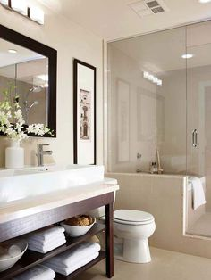 When bathroom space is at a premium, consider placing bathing and showering stations within one enclosure. The homeowners tucked a small soaking tub inside the walk-in shower to maximize a minimal amount of floor space. Advantageously, the two-in-one design keeps splashing water and wet footprints away from commode and vanity areas./