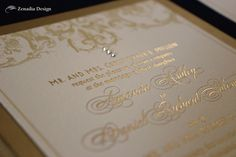 Glamorous gold wedding invitation with gold foil and Swarovski crystals, by Zenadia Design.