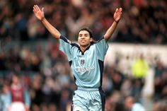 Youssef Chippo celebrates the opener in a 3-0 F.A. cup win over Burnley in 2000.