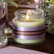 Nothing could be simpler than adding a piece of pretty ribbon to a glass jar candle — it's truly an easy and inexpensive way to dress up a plain candle and to add some romance and ambiance to your wedding space. You could also apply this same technique to empty glass candleholders and vases — just fill them with gems, sand, candles, or flowers for a dressed-up look. Here's the items you'll need (shop for items below or visit one of our stores):
