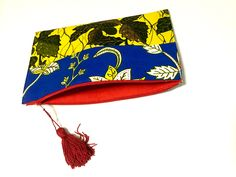 Dougla zip top clutch with tassel- blue, yellow, green, red, white · Le Gendre · Online Store Powered by Storenvy