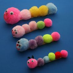 Caterpillar craft made with pom poms, popsicle sticks, googly eyes, and glue