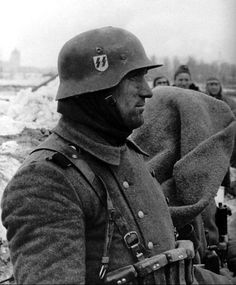 Waffen SS soldier in his trench position. Russia, 1943.