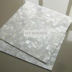 White Ornate Mother of Pearl Tile Squared Kitchen Backsplash Mosaic Tiles Bathroom Flooring Wall Stickers Mirror Back Splash Decor Mesh Shower Bathtub Tiles Countertops Bar Mosaics Natural Luster Fireplace Mother of Pearl Shell Mosaics Sheets Tile TST MOSAIC TILES http://www.amazon.com/dp/B00KBYABD6/ref=cm_sw_r_pi_dp_sFkPtb02VEBDEK87