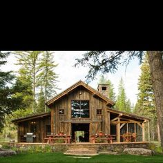 Barn idea ~ Love the casual style of this barn with the picnic tables and screened in porch