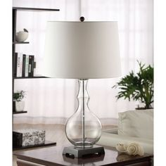 @Overstock.com.com - Clear Glass Table Lamp with Metal Base - Setting: Indoor Fixture finish: Glass and metal Shades:  White Brussels   http://www.overstock.com/Home-Garden/Clear-Glass-Table-Lamp-with-Metal-Base/5973681/product.html?CID=214117 $56.99