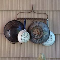 Hang old strainers on the wall