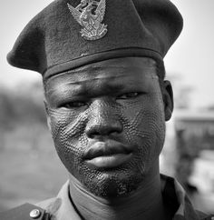 Africa | SPLA soldier with Nuer tribal scarification in Quffah, Upper Nile State, South Sudan | ©Nicolay Paus