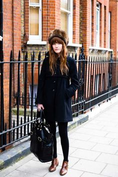 love this whole outfit. big furry hat, black in the middle, brown leather booties
