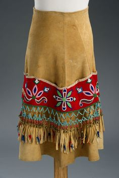 Skirt made of hide, wool, glass beads, brass bells. Beadwork created in by Meras Kinbasket, Secwepemc. She had made the clothing for her wedding trousseau but father forbade her wedding to a man from different nation Native American Clothing, Native American Regalia, Native American Beadwork, Native American Fashion, Native American Indians, American Apparel, Powwow Regalia, Indian Beadwork, Ribbon Skirts