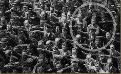 """The photo was taken in Hamburg in 1936, during the celebrations for the launch of a ship. In the crowd, one person refuses to raise his arm to give the Nazi salute. The man was August Landmesser. He had already been in trouble with the authorities, having been sentenced to two years hard labour for marrying a Jewish woman."""