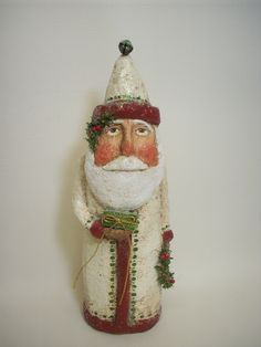 Primitive Paper Mache Folk Art Santa with Wreath and Gift. $75.00, via Etsy.
