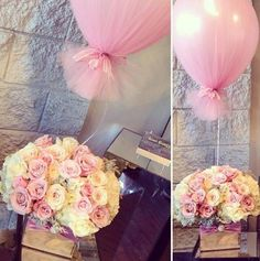 Blush and ivory centrepiece with balloon