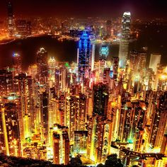 Hong Kong at Night - The photo was taken from a lookout point on Victoria Peak. Victoria Peak is a mountain in the western half of Hong Kong Island. City Lights At Night, Night City, City Ville, Lac Michigan, Hong Kong, New York City, City That Never Sleeps, Belle Photo, Cities