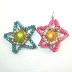 2 Wired Mercury Bead Dimensional Star Christmas Ornaments...