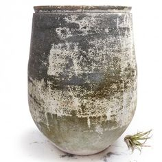 Large Green Glazed Pot  This ceramic vessel is handcrafted in the Netherlands and features a weathered patina.