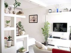 white shelving unit used as room divider