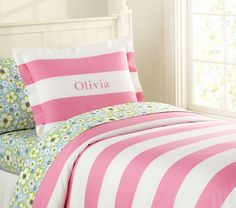 #17college Yes it's from a kids store but cute twin comforters are hard to find and I absoletly love this one! It's sporty because of the stripes but pretty because of the pink :) & no I will not be getting my name monogramed onto the pillow sham! [Rugby Stripe Duvet Cover]
