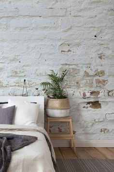 This charming white brick wallpaper is great for adding an industrial feel to your bedroom Team it with soft fabrics for a cosy bedroom Find this white brick wallpaper and more at Brick Wallpaper Bedroom, Brick Wall Bedroom, White Brick Wallpaper, Feature Wall Bedroom, White Brick Walls, Accent Wall Bedroom, Bed Wall, Wall Wallpaper, Brick Wallpaper Interior