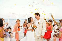 Flower petal celebration after the ceremony of a beach wedding at the Moon Palace Resort in Cancun.   Mexico wedding photographers Del Sol Photography
