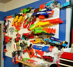 My Husband Hangs His Nerf Guns Armory Style In Our Bedroom