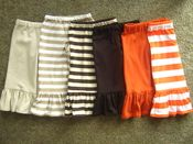 All of the ruffle pants/capris/shorts and dresses here!