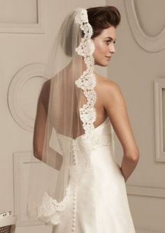 A Spanish veil, also called a bridal mantilla veil, is one of the most beautiful and dramatic long veils you can wear on your wedding day. While they are very elegant, they are also very expensive. Can you make this long veil work for your budget? Mantilla Veil, Lace Veils, Fingertip Veil, Spanish Veil, Wedding Veils, Wedding Dresses, Lace Wedding, Bridal Veils, Wedding Garters