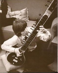 Young George Harrison Playing the Sitar