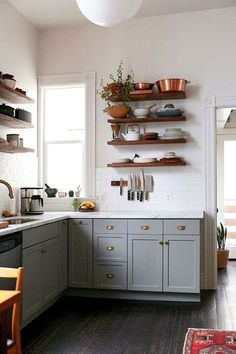 copper pots and gray kitchen cabinets. / sfgirlbybay