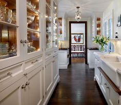 O'Brien Harris - galley kitchen, floor to ceiling china cabinets, dual farmhouse sinks, beveled marble counters, chocolate stained floors.