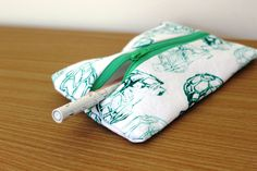 Hand-printed hand-sewn green turtle pouch by Yoliprints on Etsy