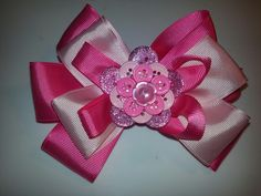Large pink hair bow with button flower