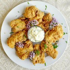 Chicken Fried Cod Nuggets Recipe Main Dishes with cod fillets, vegetable oil, flour, grated nutmeg, cayenne pepper, salt, ground black pepper, ground thyme, ground oregano, eggs, milk, large egg yolks, salt, sugar, cayenne pepper, lime, mild olive oil, lime, chives