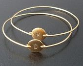 Personalized Bridesmaid Jewelry, Set of 4 Gold Initial Bracelets, Personalized Bridesmaid Bracelet Set, Bridesmaid Set Monogram Gift Jewelry. $112.00, via Etsy.