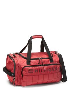 Red 20'' Sport Duffel Red Sport Duffel; Zipper top closure; Carry handles on sides and double handles on top of duffel; Exterior pockets on sides and front of bag for extra storage; Removable, adjustable shoulder strap; Fully lined; Protective feet at bottom of bag; Reflective logo on front Duffel #StorageBags #Handbags