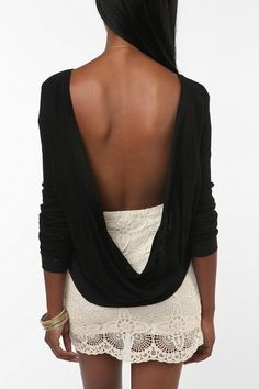 Love backless shirts... I need this... or so I thought! Tried it on, it was hideous! Short, almost mid-drift in front and made of t-shirt material-- CHEAP t shirt material-- so no going bra-less!