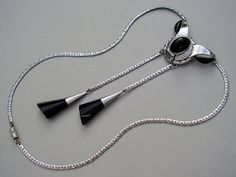 Vintage German Art Deco Jakob Bengel Machine Necklace by TheLovelyJumble. Made from chrome-plated brass and set with 3 black glass cabochons and two multifaceted drops.