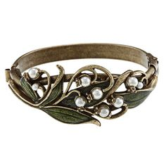 @Overstock - Add a unique accent to your wardrobe with this art nouveau Sweet Romance bracelet. The bracelet features sculpted leaves with faux pearl blossoms that are sure to attract attention. Keep it secure around your wrist with its hidden box clasp.http://www.overstock.com/Jewelry-Watches/Sweet-Romance-Art-Nouveau-Lily-of-the-Valley-Bracelet/3169176/product.html?CID=214117 $59.99