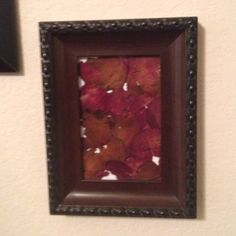 Have dried rose petals you don't know what to do with? How about putting them in a picture frame? This way the sentimental petals are safe and beautifully displayed!