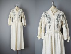 1950s cream quilted full-length housecoat features soutache and rhinestone details, ¾ sleeves with bow finish, a matching attached belt,