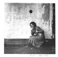 From Polka Dots series, Providence, Rhode Island, 1975—1978 - Francesca Woodman        About the Work    About From Polka Dots series, Providence, Rhode Island    This photograph, one of Francesca Woodman's most famous, depicts a young woman eerily crouched in the corner of a desolate room. As with most of Woodman's photographs, this image has an air of gloom; the woman looks frightened, and her partially exposed breast hints at her vulnerability.