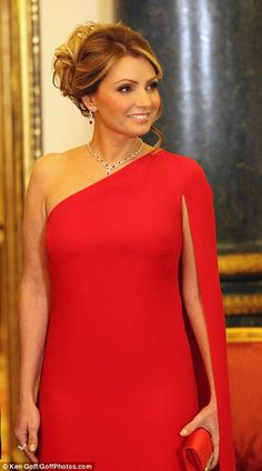 Angelica Rivera also carried a red satin clutch, while her hair was styled in a loose up-d...