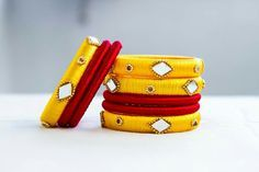 yellow and maroon silk thread bangles To order whatsapp on 9703870603 Silk Thread Bangles Design, Silk Thread Necklace, Silk Bangles, Thread Jewellery, Bangles Making, Thread Art, Textiles, Bangle Set, Making Ideas
