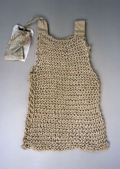 This is a vest from one of the World Wars! I love this, and think it would be perfect for summer, in hemp or linen.