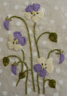 Embroidered and appliqued pansies.