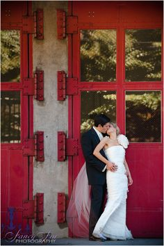 couple: groom behind, bride leaning back for kiss and hands on waist