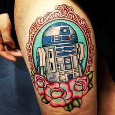 Repost from @merrytattoo. Beyond stoked with my first tattoo.  starwars tattoo starwarstattoo r2d2 droid artoo nerd… by codeedear - instaview.me  I love the flowers and of course R2